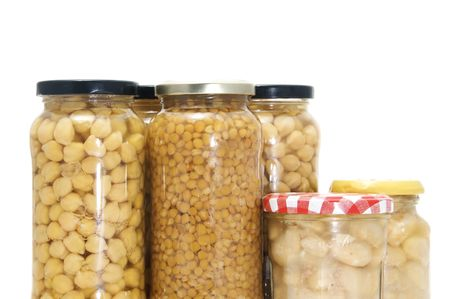 legume: some jars of canned legume isolated on a white background