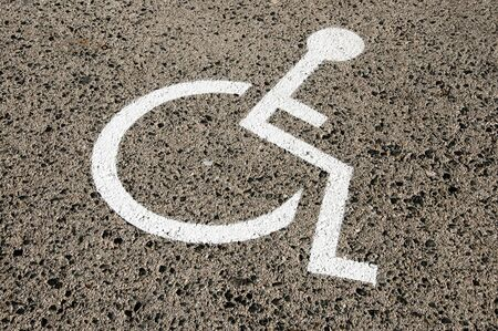 Disabled parking permit sign painted on the street Stock Photo - 6690118