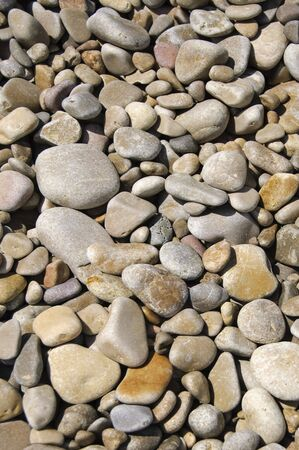 shingle beach: background made of a closeup of a pile of pebbles Stock Photo