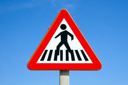 pedestrian crossing sign over the blue sky photo