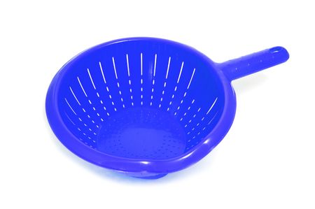 percolate: a blue plastic colander isolated on a white background Stock Photo