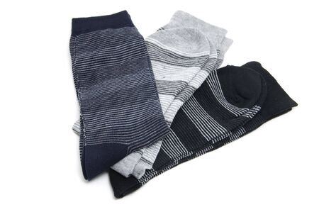 some pairs of striped socks isolated on a white background photo