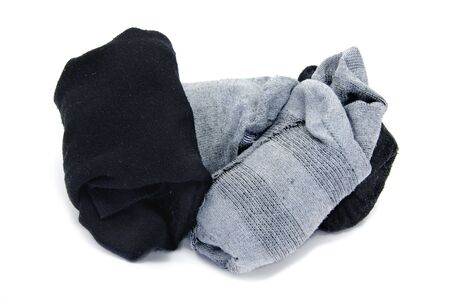 some pairs of striped socks folded isolated on a white background photo