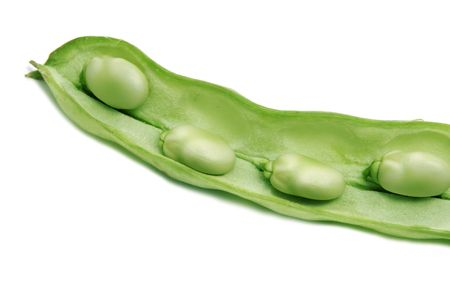 haba: close up of some broad beans inside the pod