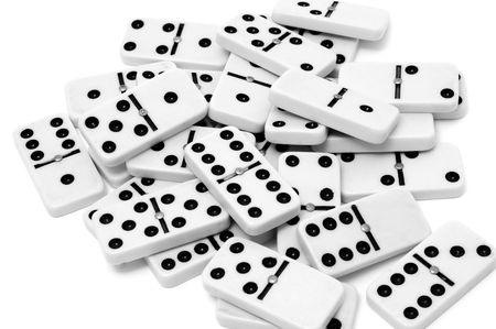 dominoes: a pile of domino pieces isolated on a white background