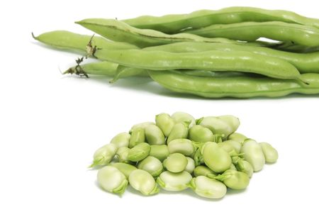 haba: some broad bean pods and some broad bens isolated on a white background