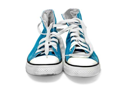 training shoes: a pair of blue sneakers isolated on a white background Stock Photo