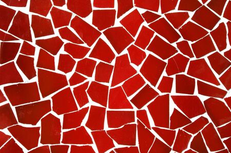 background made of an abstract pattern made with red mosaic bits photo