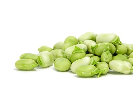 haba: closeup of some broad beans isolated on a white background Stock Photo