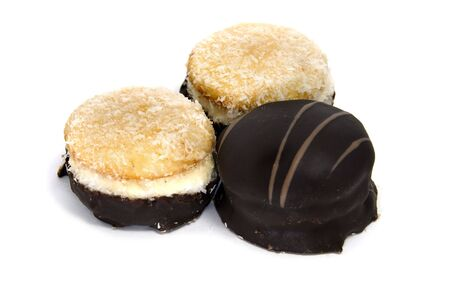 alfajores: some stuffed biscuits isolated on a white background