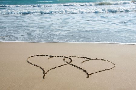 hearts drawn on the sand of the beach Stock Photo - 6849954