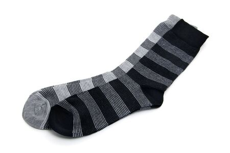 a pair of striped socks isolated on a white background photo