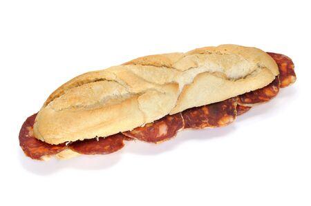 embutido: spanish chorizo sandwich isolated on a white background