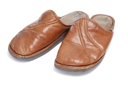 houseshoe: a pair of brown slippers for man isolated on a white background