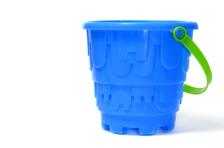 children sandcastle: a blue castle bucket isolated on a white background