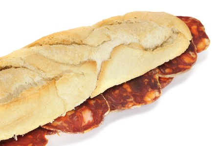 closeup of a spanish chorizo sandwich isolated on a white background photo
