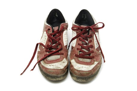a pair of worn sneakers isolated on a white background Stock Photo - 6898358
