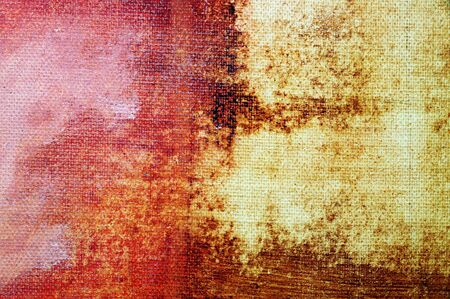 peeling paint: vintage background of different colors on a canvas