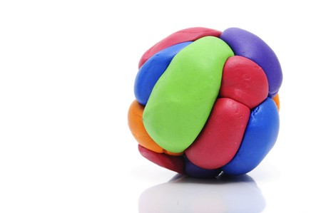 clay craft: a modelling clay ball of different colors isolated on a white background