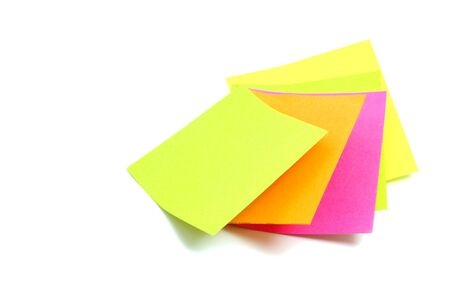 yellow tacks: some post-it notes of different colors on a white background