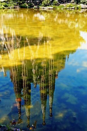 sagrada: reflection in the water of the Sagrada Familia in Barcelona, Spain