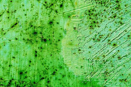 background made of a close-up of a green cracked wall Stock Photo - 6952782