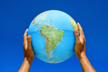 terrestrial globe: someone holding a globe in his hands Stock Photo
