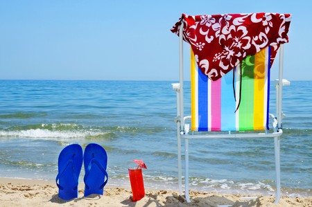 deckchair, swim suit, flip-flops and cocktail on the beach Stock Photo - 6952832