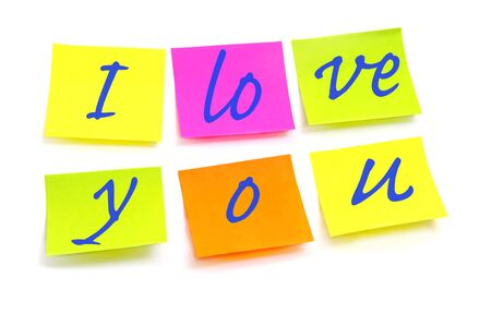 I love you written on post-its of different colors on a white background Stock Photo