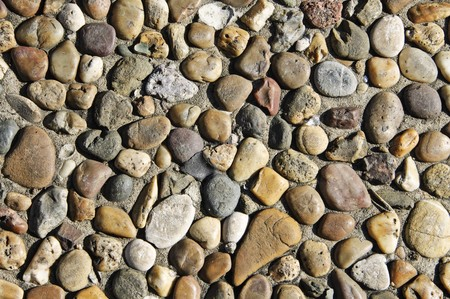 background made of a closeup of a wall with pebbles photo