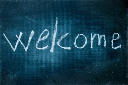 welcome written with a chalk on a blackboard photo