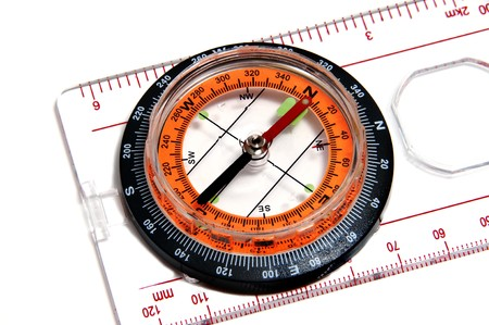 closeup of a ruler with compass isolated on a white background photo