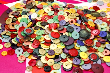 buttons of many colors and shapes on a background of different colors photo