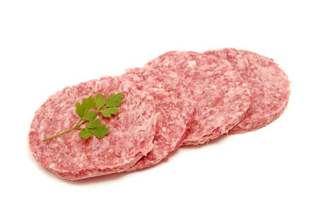 a pile of raw burgers isolated on a white background photo