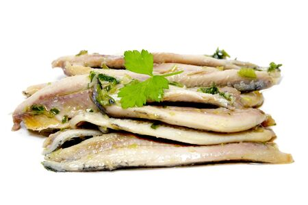 a pile of anchovies in vinegar isolated on a white background photo