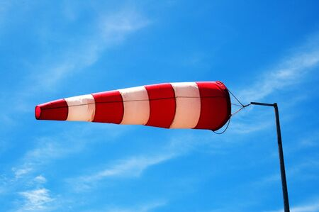a windsock inflated by the wind on the sky photo