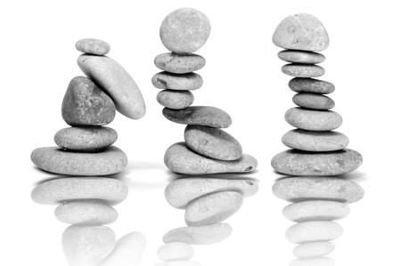 inukshuk: a pile of zen stones on a white background