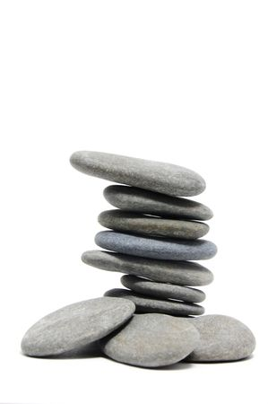 a pile of zen stones on a white background photo