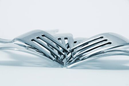 tine: a pile of forks on a degraded background