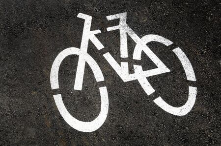 bicycle-only lane sign painted on the street Stock Photo - 7060354