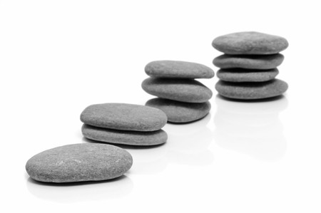 some piles of zen stones on a white background Stock Photo - 7114550