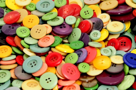textile designer: closeup of a pile of buttons of many colors Stock Photo