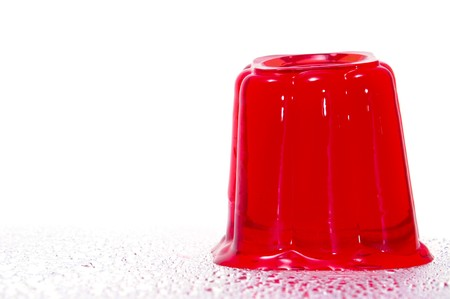 gelatin: a red gelatin isolated on a white background