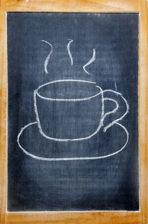 a cup of coffee drawn on a blackboard photo