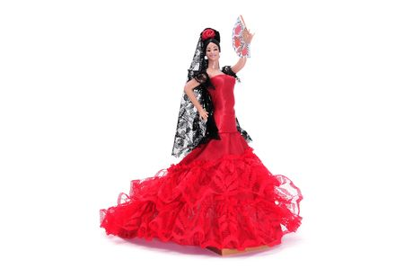 a frill: a typical spanish doll dressed as a flamenca isolated on a white background Stock Photo