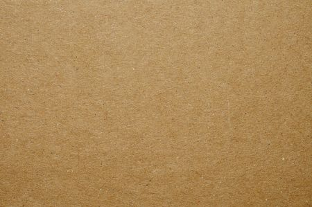 cardboard background: background made of a closeup of brown cardboard Stock Photo