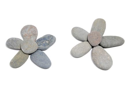 karesansui: flowers made with stones on a white background
