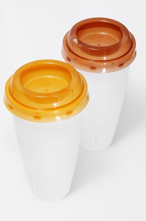 throwaway: two plastic cups with lids isolated on a white background