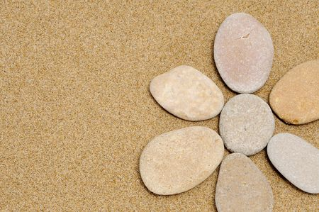 flower made with stones on a sand background Stock Photo - 7184944