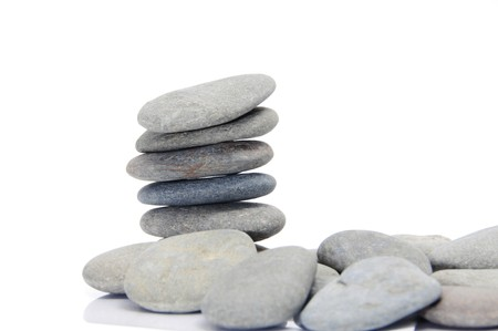a pile of zen stones on a white background Stock Photo - 7221912